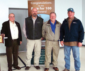 Matt Miles, Nelson Crow and Eddie Tackett pose with Lanny Ashlock, left, after fielding questions from fellow producers on achieving the goal of 100 bushels per acre in Arkansas. The three were named winners in the 2013 Race for 100.