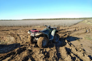 ATV by a muddy soybean field in Arkansas